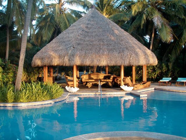 Poolside tiki hut cabana for Pool hut designs