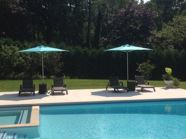 Poolside Wicker Lounge Chairs And Market Umbrella
