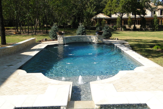Elegant Roman Shaped Pool With Cannon Jets Copper Bowls Travertine Deck Traditional Pool
