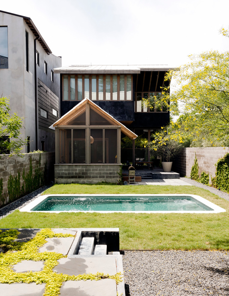 Example of a small trendy backyard concrete and rectangular lap pool design in Houston