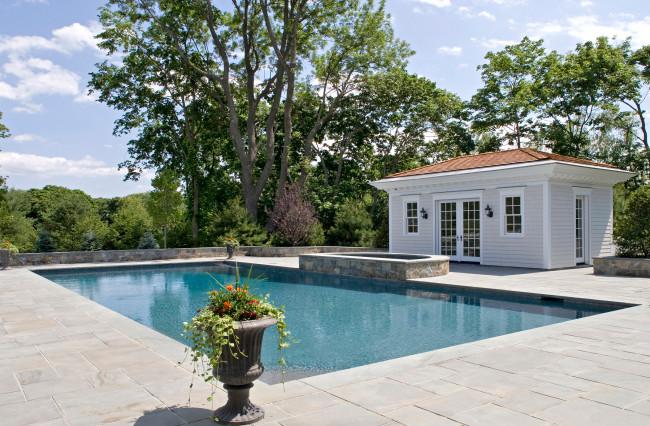Large elegant backyard stone and rectangular lap pool house photo in New York