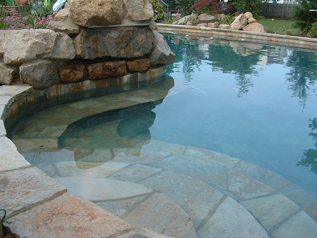 Quartzite natural stone used in swimming pool projects for Natural rock swimming pools