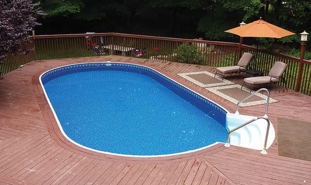 Radiant oval above ground pool with composite decking transitional pool detroit by pools - Above ground composite pool deck ...