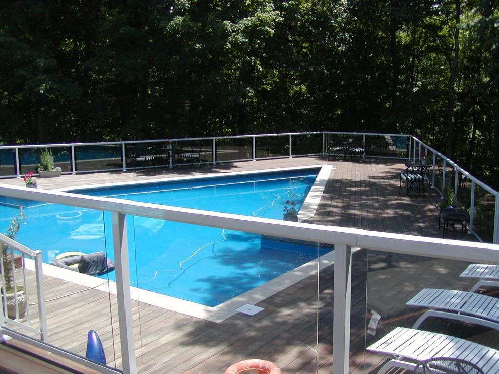Mid-sized elegant backyard custom-shaped lap pool photo in Indianapolis with decking