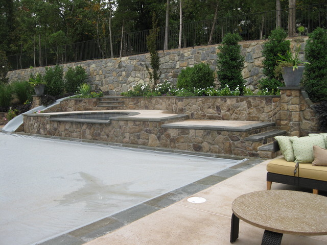 Raised Built-In Slide at Hot Tub and Pool Deck traditional-pool