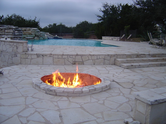 Ranch Home Freeform Pool With Limestone Deck And Fire Pit