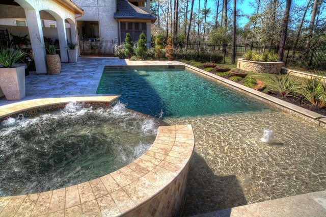 rectangular pool with walkover water feature fire pit and landscape contemporary pool