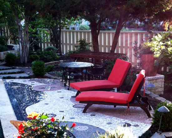Chaise and Steamer Lounge Cushions - Customer Photo: These chaise lounge cushions add an extra pop of color to this gorgeous backyard with Sunbrella Spectrum outdoor fabric in Grenadine.