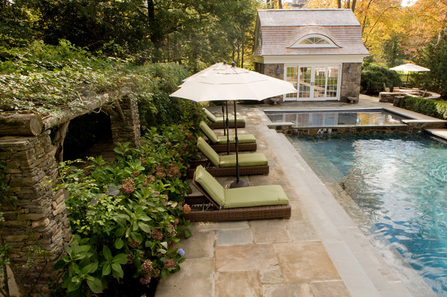Relax by the pool or in the pool house... traditional pool