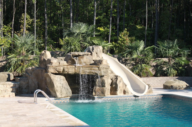 rico rock grotto waterfall and slide into pool tropical pool