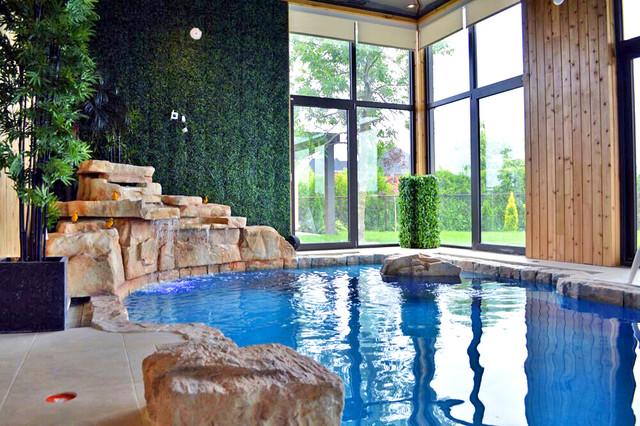 RicoRock Indoor Swimming Pool Waterfall rustic-pool