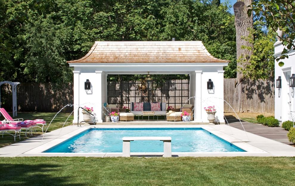 Elegant rectangular pool house photo in Chicago