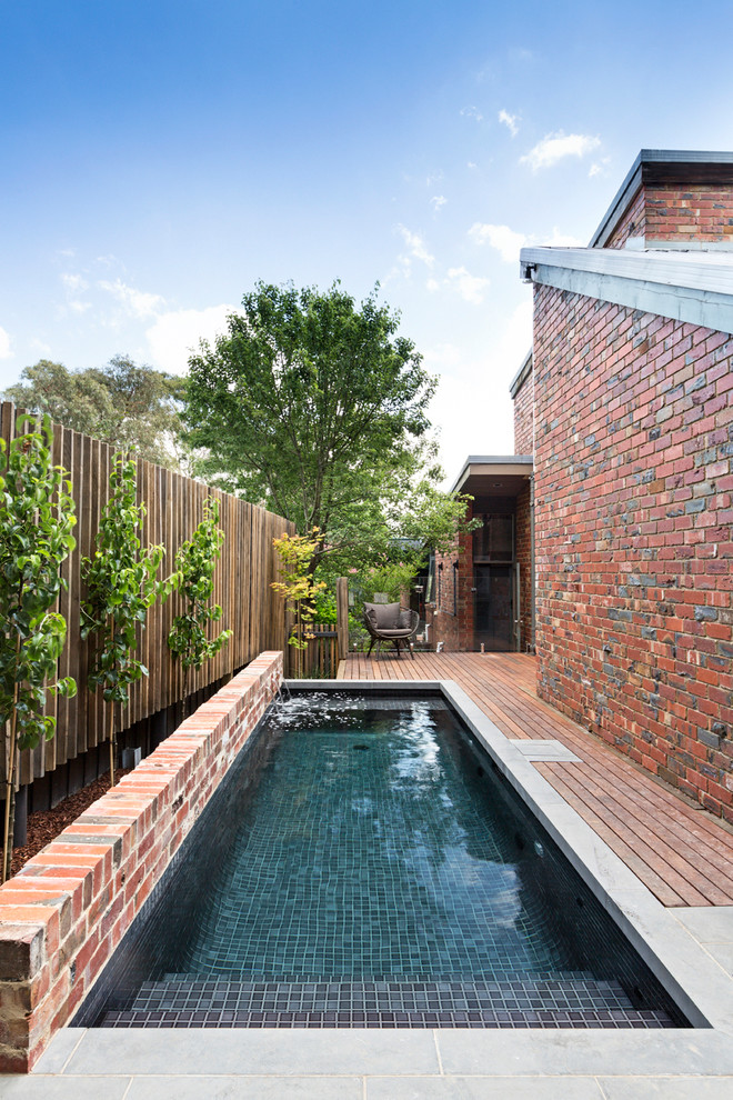 Small trendy rectangular pool fountain photo in Melbourne with decking