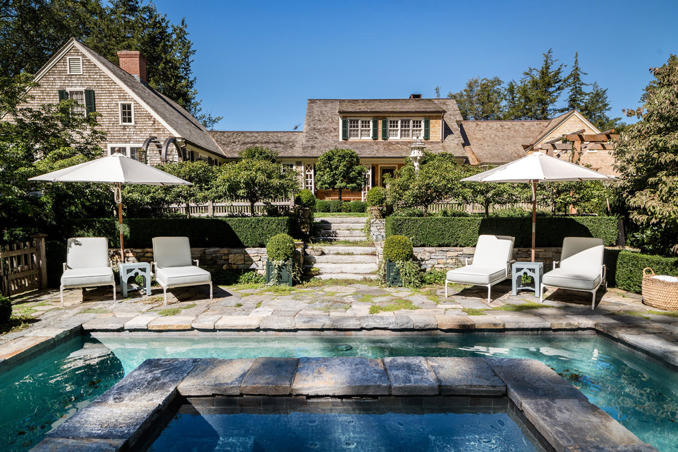 Cottage chic pool photo in New York