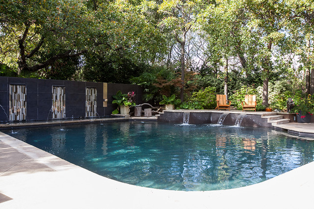Inspiration for a large contemporary backyard concrete and custom-shaped natural pool fountain remodel in Dallas