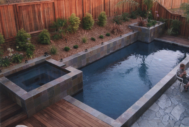 modern pool by Huettl Landscape Architecture