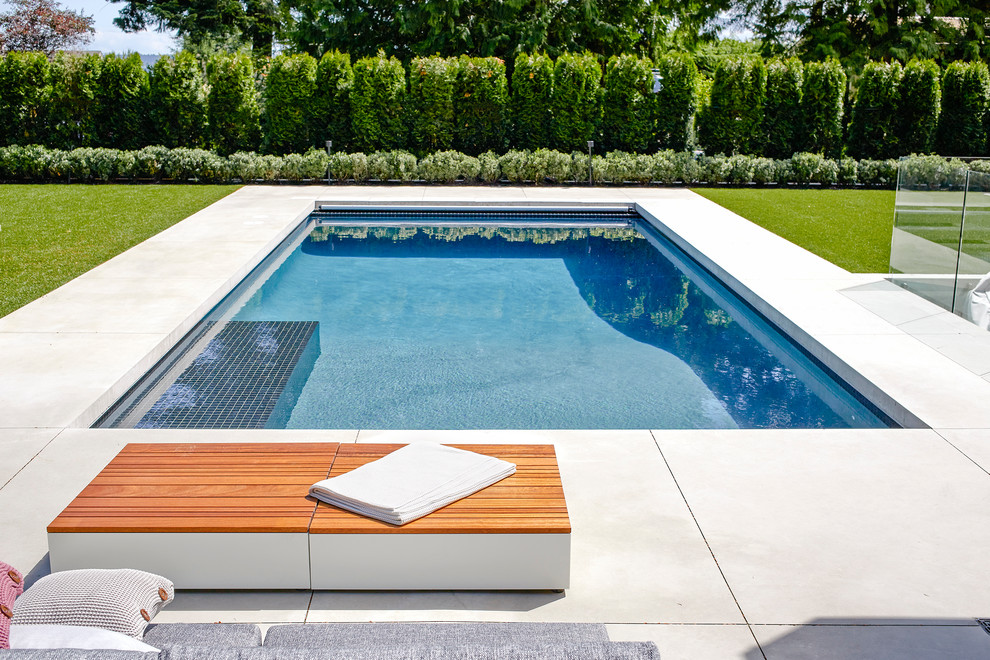 Pool - large contemporary stamped concrete and rectangular pool idea in Vancouver