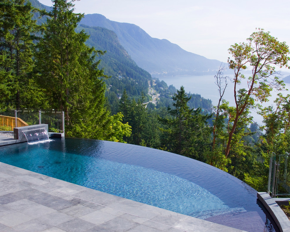 Inspiration for a rustic backyard rectangular infinity pool remodel in Vancouver