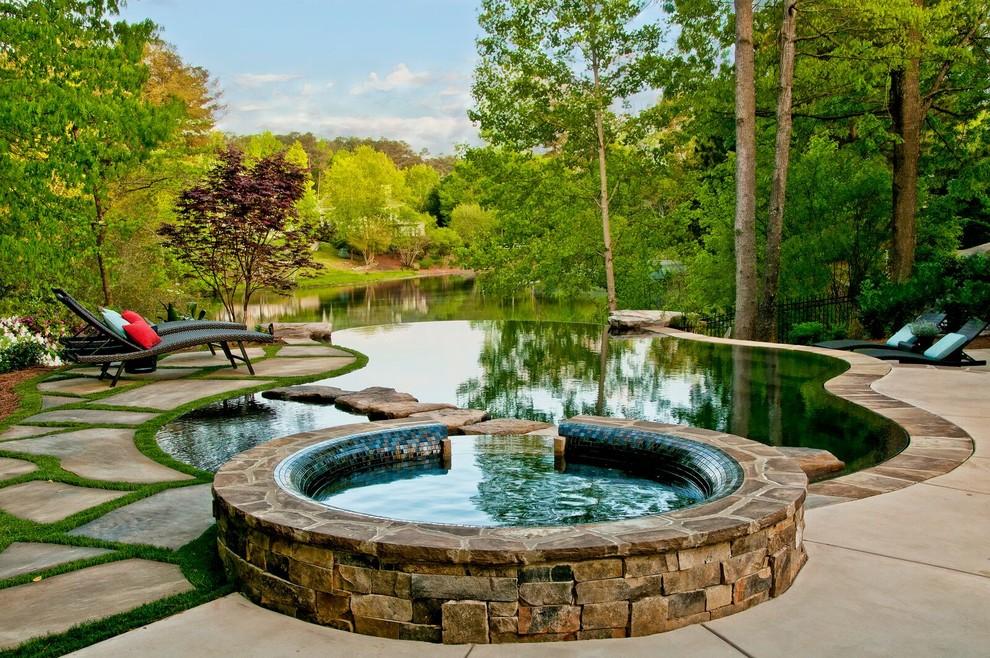 Inspiration for a rustic custom-shaped infinity hot tub remodel in Atlanta