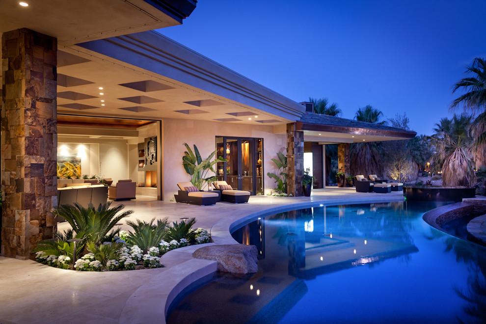 Pool - tropical backyard custom-shaped pool idea in San Diego