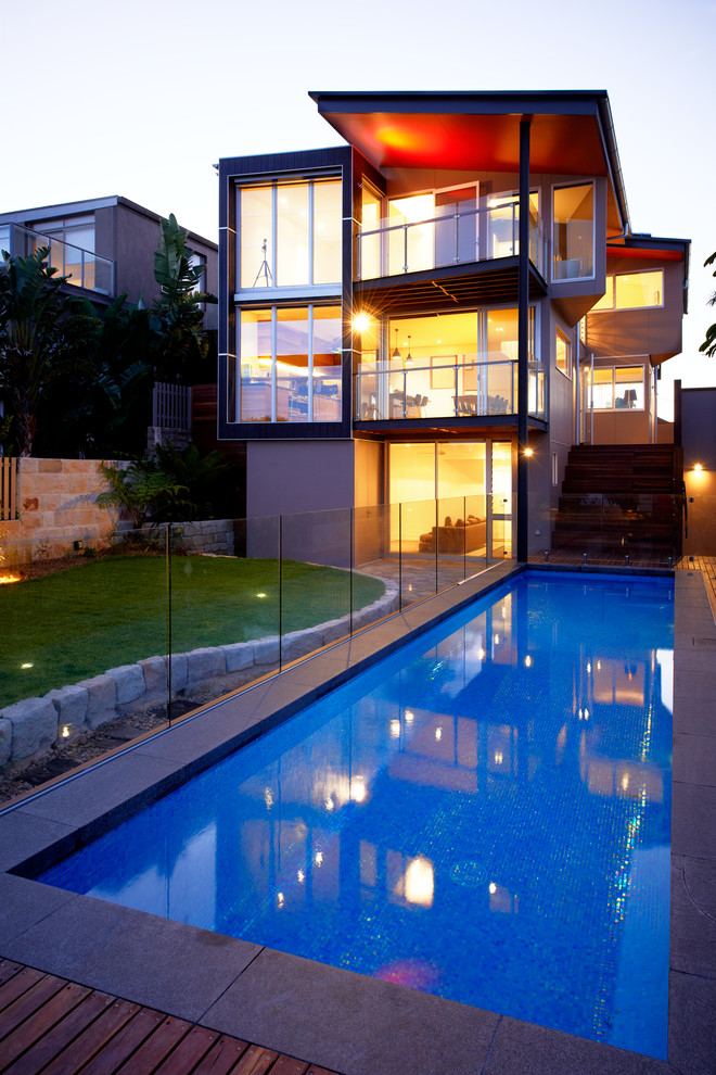 Pool - mid-sized contemporary backyard rectangular and concrete paver lap pool idea in Sydney