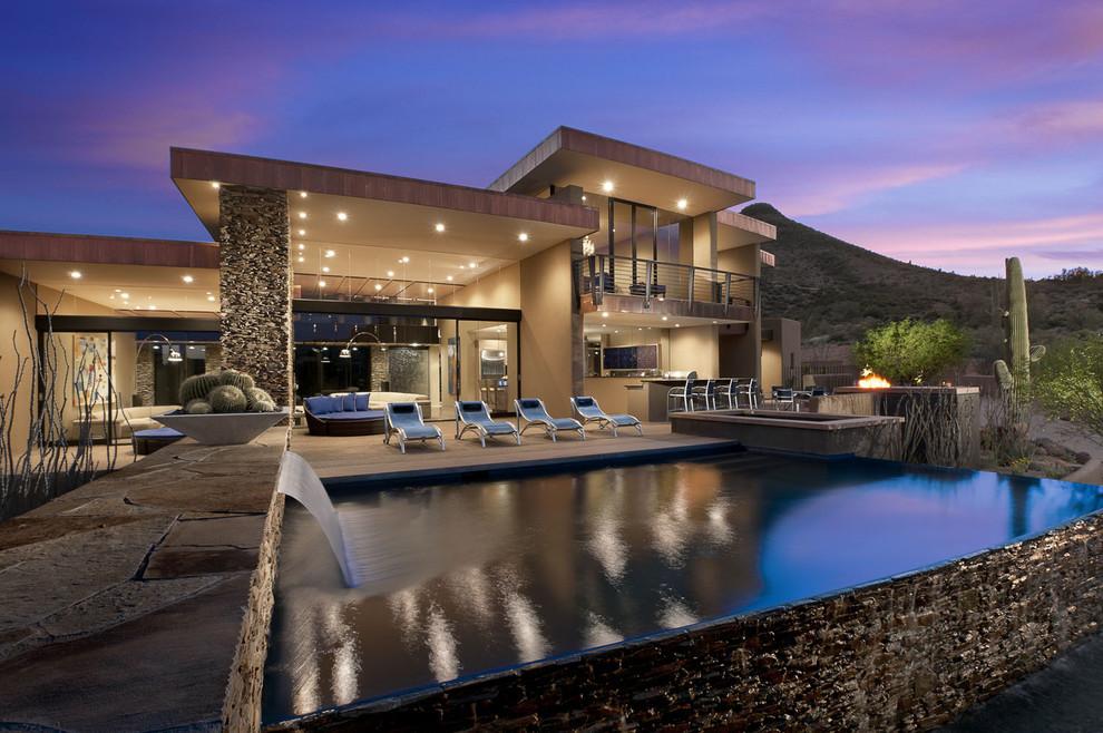 Pool - mid-sized southwestern rectangular infinity pool idea in Phoenix