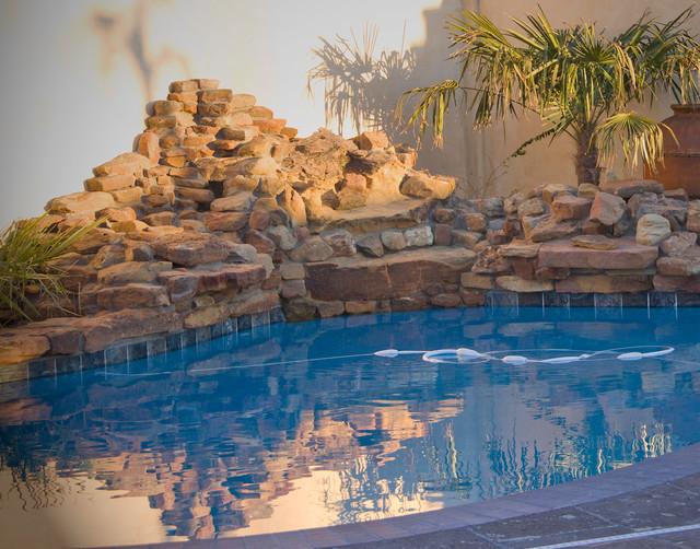 Pool - small mediterranean side yard tile pool idea in Austin