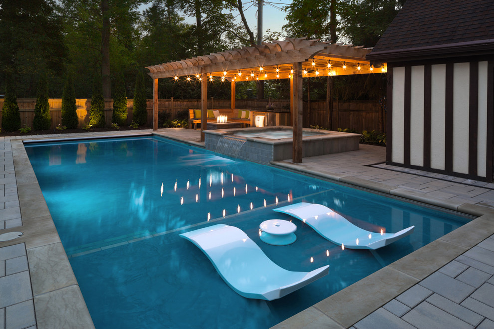 Hot tub - traditional backyard rectangular and concrete paver hot tub idea in Cleveland