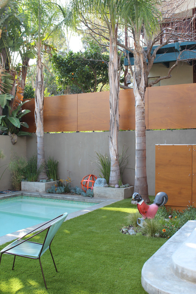 Inspiration for a contemporary backyard rectangular pool remodel in Los Angeles