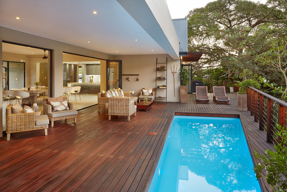 Trendy pool photo with decking