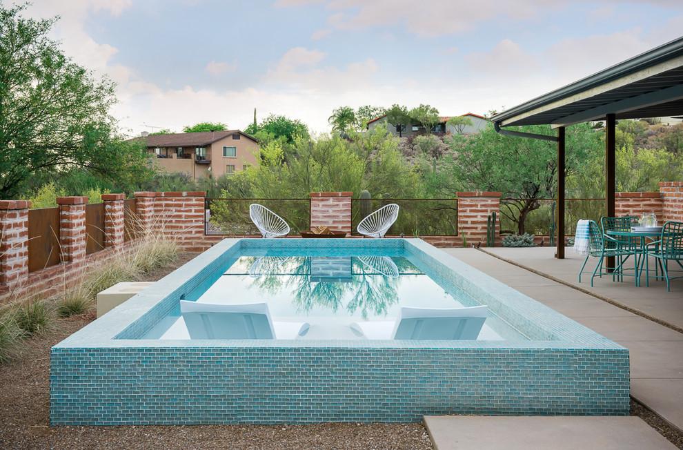 Pool - small southwestern backyard concrete and rectangular pool idea in Phoenix