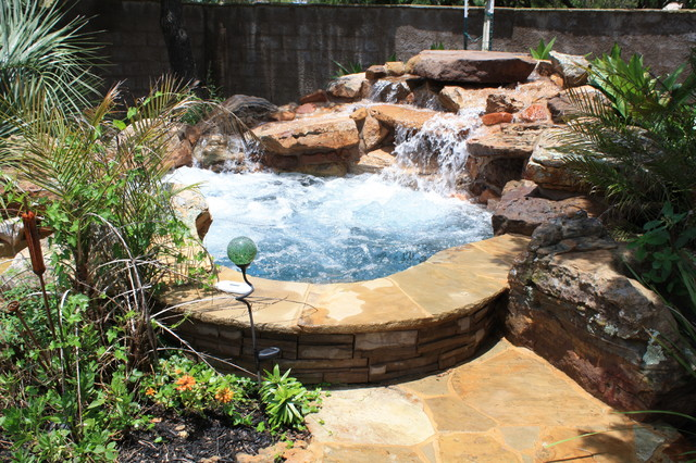Spa With Large Rock Waterfall