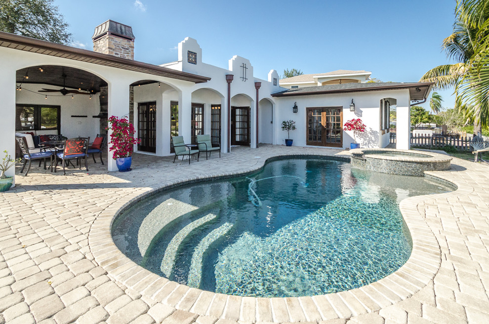 Inspiration for a mediterranean pool remodel in Tampa