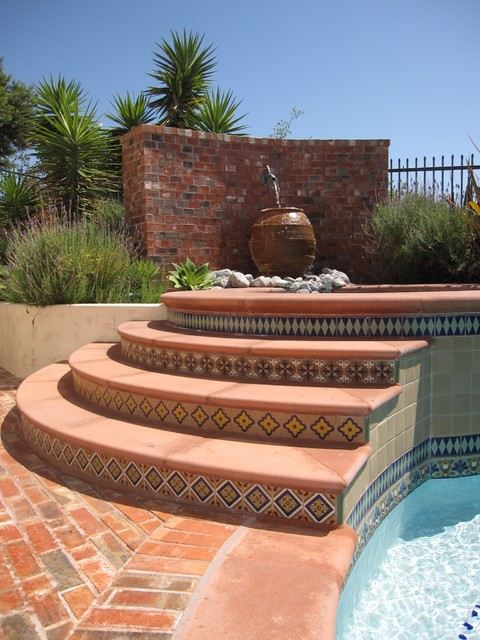 Example Of A Tuscan Brick Pool Fountain Design In Orange County