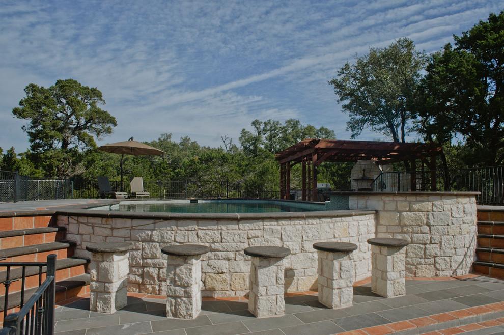 Hot tub - huge rustic backyard tile and custom-shaped aboveground hot tub idea in Austin