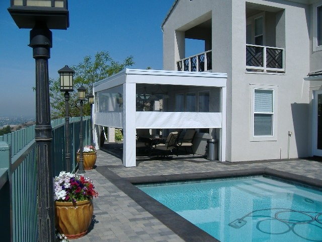 Specialty backyard attached cabana with motorized shades for Motorized shades los angeles