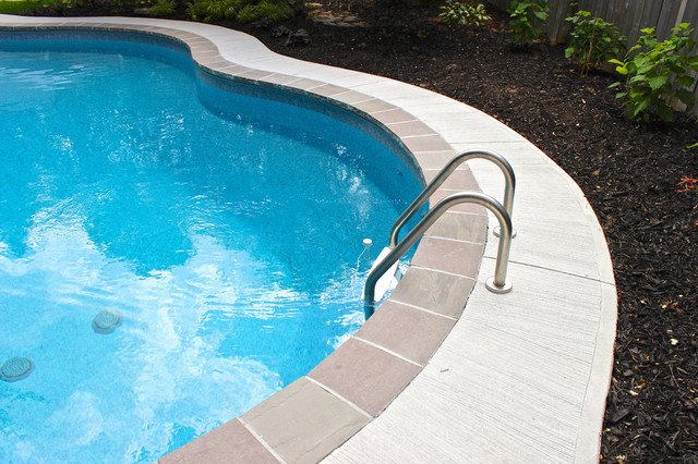 Stone Coping and Concrete traditional-pool