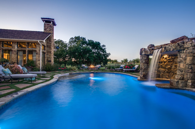 Stone oasis luxury swimming pool with grotto and fire for Luxury swimming pools