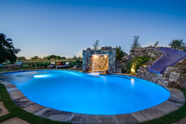 Stone oasis luxury swimming pool with grotto and slide for Luxury swimming pools