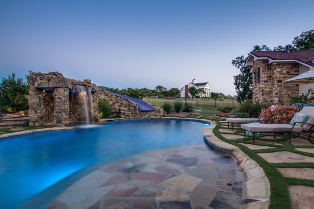 Stone oasis luxury swimming pool with grotto and slide for Pool design dallas texas