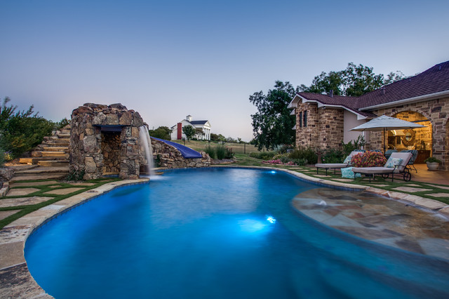 Stone oasis luxury swimming pool with grotto and slide - Luxury swimming pools ...