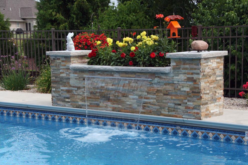 Backyard stone pool fountain photo in Milwaukee