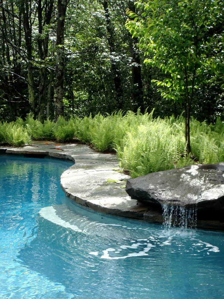 Example of a classic custom-shaped pool fountain design in Burlington