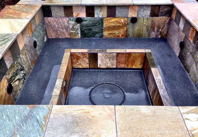 Hot tub - mid-sized modern backyard stamped concrete and custom-shaped hot tub idea in Portland