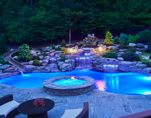 Swimming Pool with rock decor, waterfall, and lighting effects