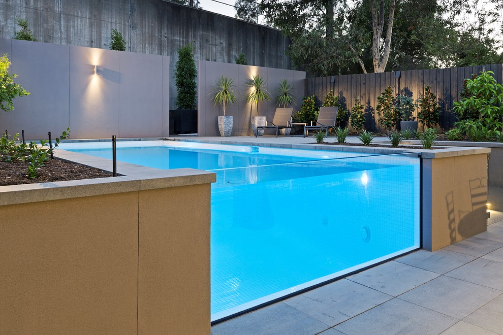 Example of a mid-sized minimalist backyard stone and rectangular aboveground pool design in Melbourne
