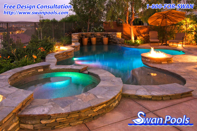 Swan pools custom design a glowing evening eclectic for Pool design orange county
