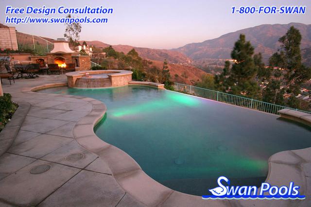 Swan pools custom design hillside oasis mediterranean for Pool design hillside