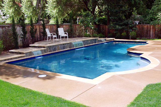 Swan pools swimming pools construction company for Pictures of swimming pools in backyards
