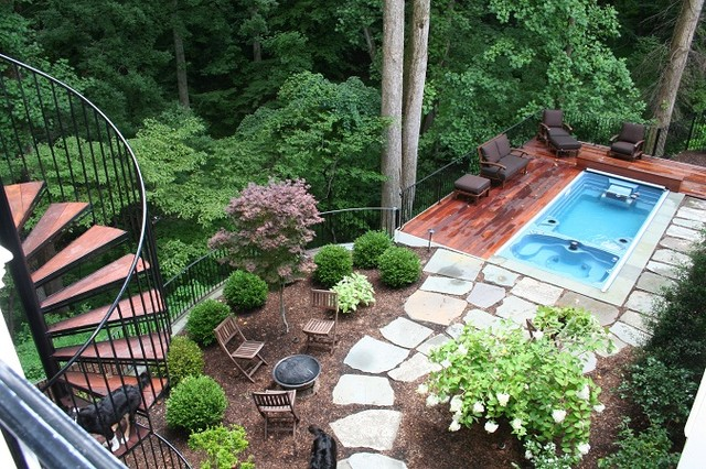 Swimming Pool And Deck On Steep Slope In McLean Backyard